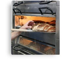 Loaves of bread in an oven.  Canvas Print