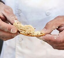 Baker inspects the baked bread  by PhotoStock-Isra