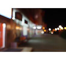 Night urban scene with diffuse lighting shop windows Photographic Print