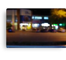 Night urban scene with blurred lights and the shopping center Canvas Print