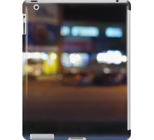 Night urban scene with blurred lights and the shopping center iPad Case/Skin