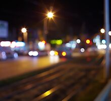 Defocused and blur city night scene with blurred lights by vladromensky
