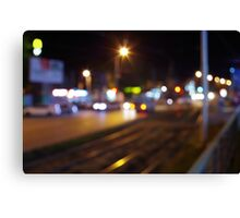 Defocused and blur city night scene with blurred lights Canvas Print