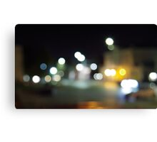 Defocused and blur city night scene with blurred lighting Canvas Print