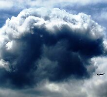 Flying through clouds, New York City  by Alberto  DeJesus