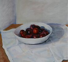 white bowl with plums by Jeremy Wallace