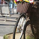 Bicycle with floral basket by Antoine de Paauw
