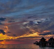 Sunset At Naples Pier by Lynne Morris