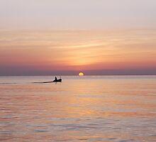 Boat at sunrise by BDomanska