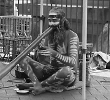 Aborigine Playing Didgeridoo  by Stan Owen