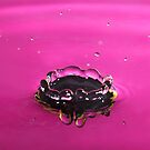 Pink water splash crown iPhone case by Esther  Moliné