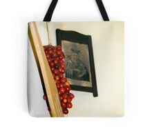 A bunch of tomatoes on a hook Tote Bag