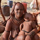 Himba woman with her baby by Jessica Henderson