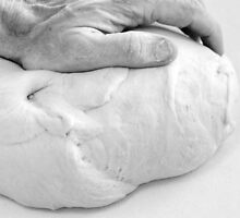 Hands of a baker kneading dough in a bakery at night. by PhotoStock-Isra