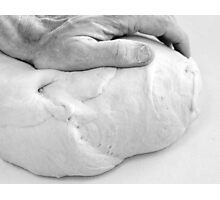 Hands of a baker kneading dough in a bakery at night. Photographic Print