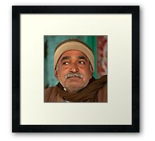 Wary Shopkeeper Framed Print