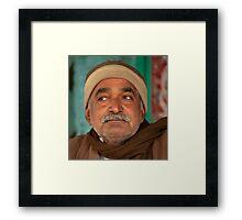 Wary Shopkeeper Framed Print