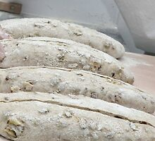 The shaped loaves are allowed to leaven before baking,  by PhotoStock-Isra