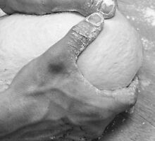 Hands of a baker kneading dough in a bakery at night by PhotoStock-Isra