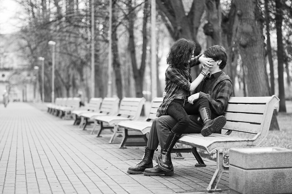 Couple in park by Anete Bauere