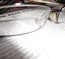 Glasses and Newspaper by Catinabucket