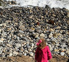Pink on Pebble Beach, Girl Throwing Stones, Los Angeles by Jane McDougall