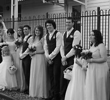 wedding group in b/w at train station by gaylene