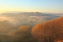 Misty Valley  by wanderingtrucki