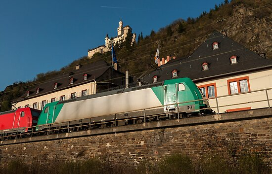 Freight train passing the Marksburg Castle, Braubach, Rhine Valley, Germany. by David A. L. Davies