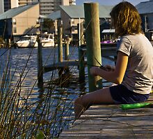 Making a reed boat on dock in Orange Beach Alabama  by KSKphotography