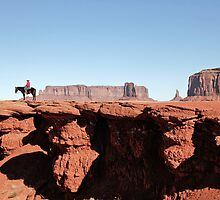 Navajo Indian at John Ford Point, Monument Valley, Utah by Martin Lawrence