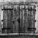Old weathered wooden window shutters in Croatia by Luke Kliman