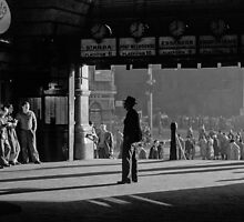 B & W Clockwatcher on entrance Flinders St station19580904 0001 by Fred Mitchell