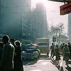 Cnr Collins & Elizabeth Streets at end of shopping day 1957 by Fred Mitchell