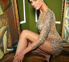Pretty woman in vintage gown posing in room with antique painting and mirror  by Anton Oparin
