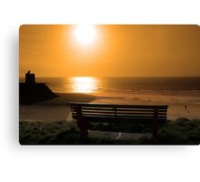 bench with golden sunset view Canvas Print