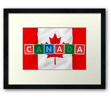 canada and flag in toy block letters Framed Print