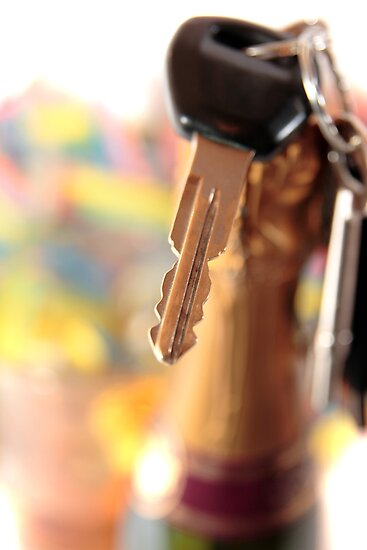car keys and golden champagne bottle top by morrbyte