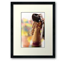 car keys and golden champagne bottle top Framed Print
