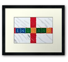 england and flag in toy block letters Framed Print