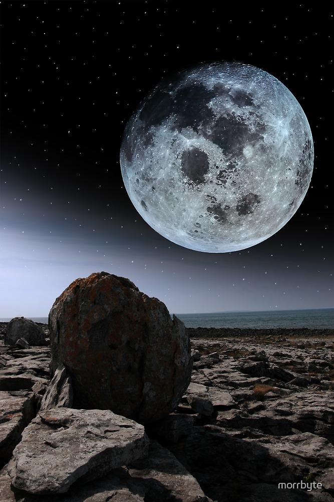 full moon and boulders in rocky burren landscape by morrbyte