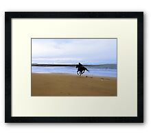 horse and rider galloping along the coast Framed Print