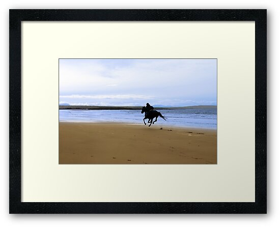 horse and rider galloping along the coast by morrbyte