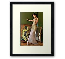 Pretty woman in vintage long gown posing  Framed Print