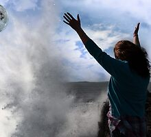 lone woman with raised hands facing a wave and full moon on cliff edge by morrbyte