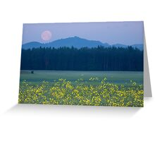 Full Moon setting over mountains and rapeseed Greeting Card