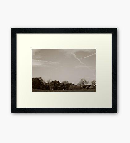 Cloud trails Framed Print