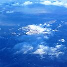 Sunlit Mountain from Plane by Karen Checca
