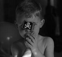 Son with pirate flag black and white image  by Jason Franklin