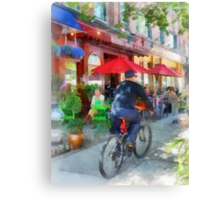 Riding Past the Cafe Canvas Print